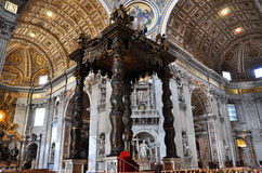 The baldachin altar made by Bernini in the Basilica San Pietro,. VATICAN, ITALY - MARCH 16, 2016: The famous wooden baldachin, altar of Saint Peter basilica was Royalty Free Stock Photos
