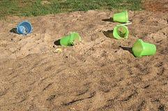 Baldes abandonados em uma pilha da areia Fotografia de Stock Royalty Free
