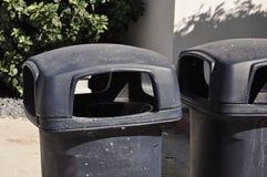 Baldes do lixo plásticos pretos Imagens de Stock