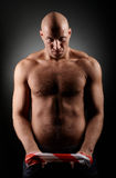 Baldhead man with hairy chest Stock Image