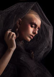 Baldhead woman. Model with a fake bald on black background Royalty Free Stock Photography