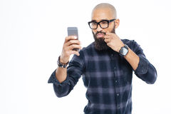 Baldheaded african american man touching moustache and taking selfie Stock Photography