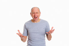 Baldheaded man with open hands looking surprised Stock Image