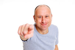 Baldheaded man pointing in to the camera and smiling Royalty Free Stock Image