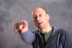 Baldheaded man pointing in to the camera Royalty Free Stock Image