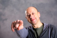 Baldheaded man pointing in to the camera Stock Images