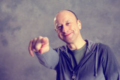 Baldheaded man pointing in to the camera Stock Image