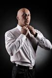 Baldman in a white shirt. A bald man in a white shirt Royalty Free Stock Photo
