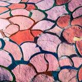 Baldosas cerámicas irregulares del color rojo y rosado foto de archivo libre de regalías