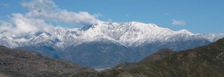 Baldy from Riverside. Snow covered mountains as seen from downtown Riverside, California Stock Photo