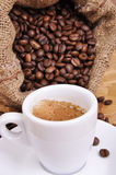 Bale of coffee beans with jalopy Royalty Free Stock Photography