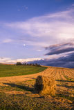 Bale of Hale. A nice landscape of a field with the full moon. This picture was taken douring the sunset in Italy Stock Photography