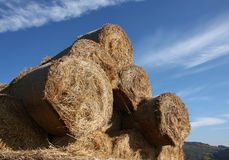 Bale of hay in stock under blue sky Royalty Free Stock Photos