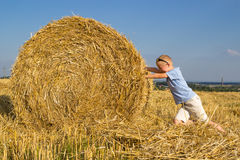 Bale straw boy Royalty Free Stock Photos