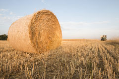 Bale of straw and tractor Royalty Free Stock Photos