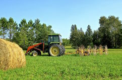 Bale, tractor, and wheel rake Royalty Free Stock Photography