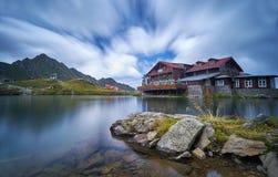 Balea Cabin on Mountain Lake Stock Images