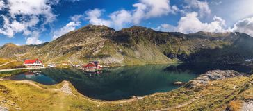Balea glacier lake near the Transfagarasan road, panoramic view. Balea Lake, is a glacier lake situated at 2034m of altitude in the Fagaras Mountains, in Stock Image