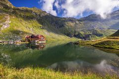 Balea glacier lake near the Transfagarasan road, panoramic view. Balea Lake, is a glacier lake situated at 2034m of altitude in the Fagaras Mountains, in Royalty Free Stock Images
