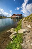 Balea glacier lake near the Transfagarasan road, panoramic view. Balea Lake, is a glacier lake situated at 2034m of altitude in the Fagaras Mountains, in Royalty Free Stock Image