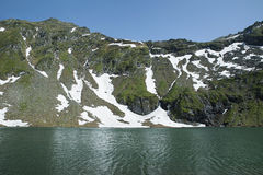Balea glacier lake next to Transfagarasan Road in Fagaras Mountains, Romania. Tranquil atmosphere at Balea glacier lake, situated at an altitude of 2034 m, in stock image