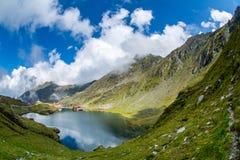 Balea glacier lake, Transfagarasan road in Romania Carpathian Fagaras mountains. With clouds and clear sky stock photo