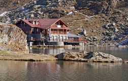Balea Lac chalet on lake Stock Image