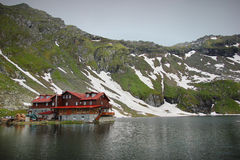Balea Lake with cabin Royalty Free Stock Images
