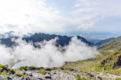 Balea Lake with clouds above. From top view. Bright blue sky on background. Fagaras Mountains, Romania stock images