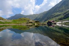 Balea Lake. Mountain lake, Balea Lake, sky reflected in water, clear lake, landscapes Stock Photos