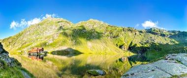 Balea lake panorama,. In Fagaras mountains, Romania royalty free stock photography