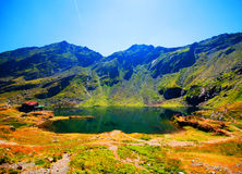Balea Lake in Romania. A picturesque overview of glacial Balea Lake in the Fagaras mountain region of Romania Royalty Free Stock Image