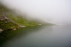 Balea Lake in Romania under a blanket of clouds Royalty Free Stock Image