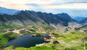 Balea Lake, seen from above. Glacial lake, on Transfagarasan hig. Hway in Carpathian mountains, Romania in summer Royalty Free Stock Images