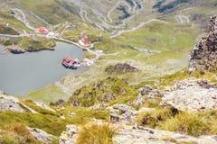 Balea Lake from top view. Focus on rocks with moss. Fagaras Mountains, Romania stock photo