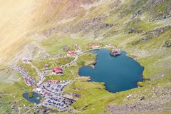 Balea Lake from top view. Traffic jams and parked cars. Fagaras Mountains, Romania stock photo