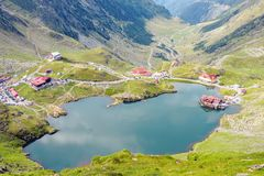 Balea Lake from top view. Traffic jams and parked cars. Fagaras Mountains, Romania royalty free stock photos