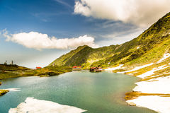Balea lake, Transfagarasan, Romania. Beautiful light at Balea Lake, Transfagarasan, Romania royalty free stock photos