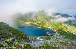Balea lake view from above. Beautiful landscape in Fagaras mountains with rising cloud on summer day Stock Photography