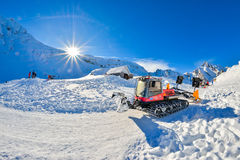 BALEA, ROMANIA - JANUARY 27 2017 - Snow grooming machine ratrak at Balea Lake in the Fagaras mountains, Romania. Snow grooming machine ratrak at Balea Lake in stock images