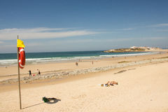 Baleal Beach and Baleal village (Peniche, Portugal) in the afternoon. General view of the long beach of Baleal with Baleal village in the horizon, located in Stock Image