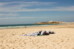Baleal Beach and Baleal village (Peniche, Portugal) in the afternoon. General view of the long beach of Baleal with Baleal village in the horizon, located in Stock Images