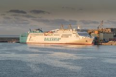 Balearia+ Lines Ferry Abel Matutes at sunrise in Palma harbour from Queen Elizabeth. 