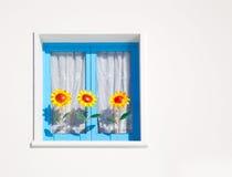 Balearic blue window with three sunflowers Royalty Free Stock Photos
