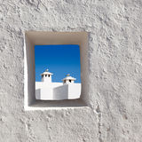 Balearic islands white chimney through window Royalty Free Stock Photos