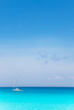 Balearic mediterranean turquoise sea with sailboat Royalty Free Stock Photo