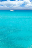 Balearic mediterranean turquoise sea with sailboat Stock Photo