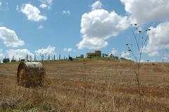 Baled hays on top of a soft hill in Chianti area. Baled hays on top of a soft hill in Chianti area in Tuscany stock image