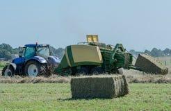Baler на haymaking стоковое фото rf