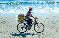 Baler, Aurora Philippines. Local vendor transporting his frozen products in a bicycle in Baler which is the famous birthplace of surfing in the Philippines. It royalty free stock images